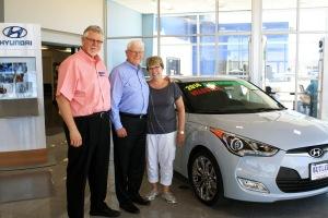 Managing partner Warren Cooper with founder/owners Chuck and Linda Butler