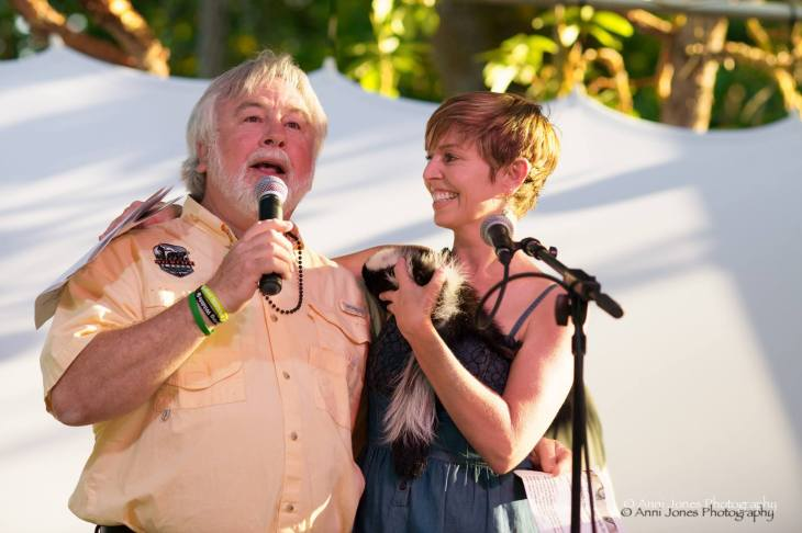 "Butler spokesperson Shannon Young emceeing the Wildlife Images Bash with executive director Dave Siddon and ""Scratch"" the skunk in July 2014.  Photo credit Anni Jones Photography"
